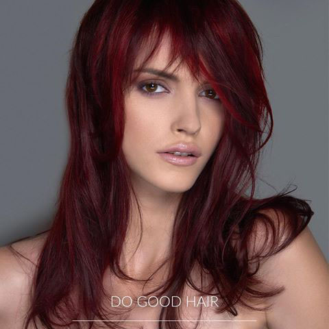 A young woman with long red hair